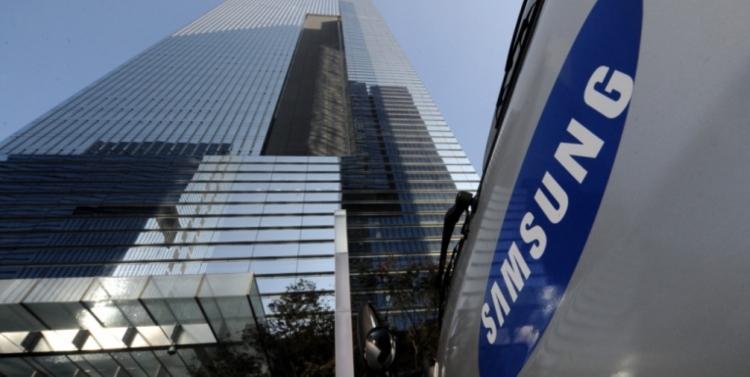 sm.samsung building and sign Medium.750 - Сделка с Samsung может помочь Qualcomm избежать штрафа в Южной Корее