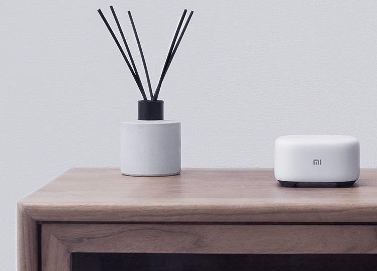 "Xiaomi Mi AI Mini: компактная акустика для дома с набором голосовых функций"""