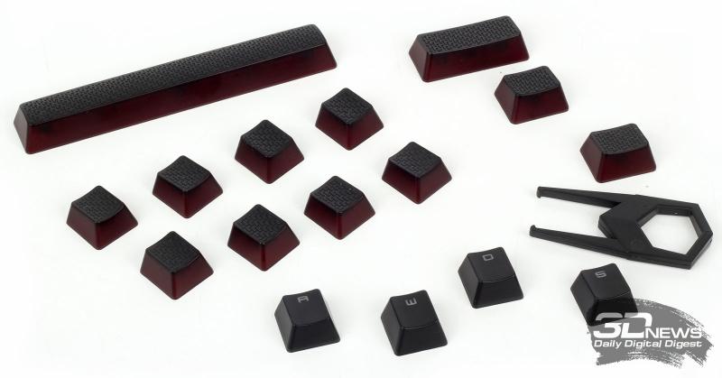 Набор сменных игровых колпачков и четыре штатных колпачка (с буквами) для сравнения