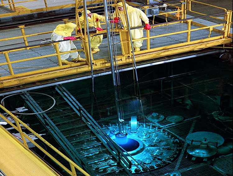 Reloading fuel in the reactor.  Image source: ORNL