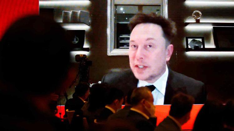 Глава компании Tesla Илон Маск убеждает киатйский бизнес, что он за ними не шпионит. Источник изображения: Reuters